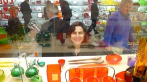 Leni peers through display of Guzzini 1960 wares